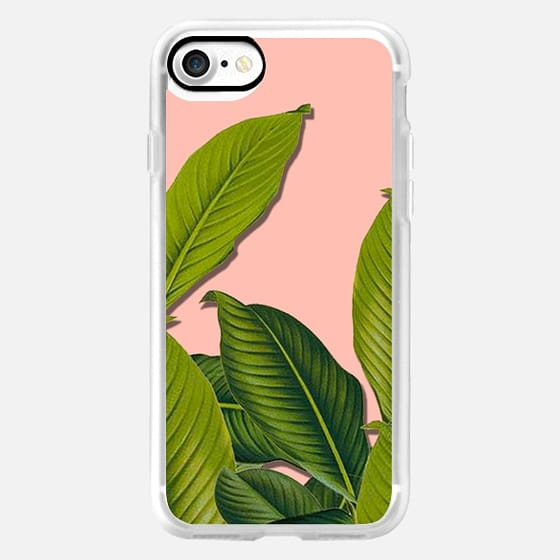 Tropical large leaves on pink -