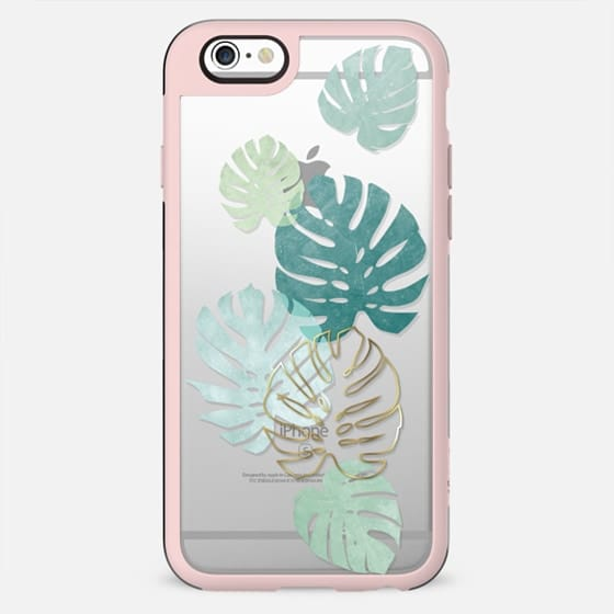 Tropical minimal green and gold monstera leaves