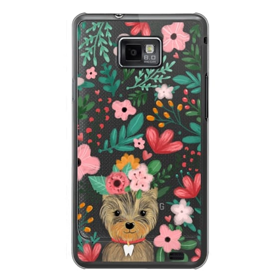 Cute yorkie dog. Yorkshire terrier with summer flowers and tooth necklace.