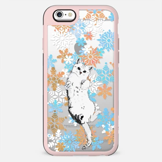 White cat and painted snowflakes