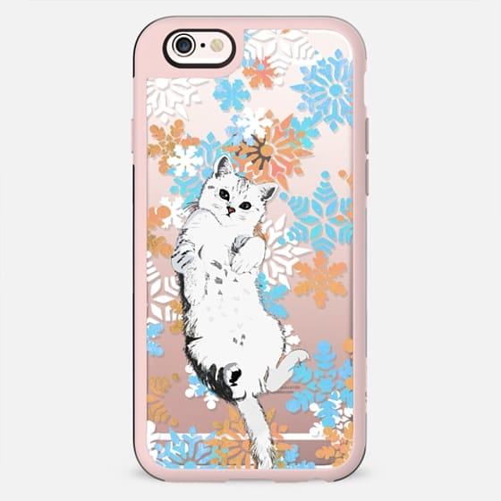 White cat and colourful snowflakes
