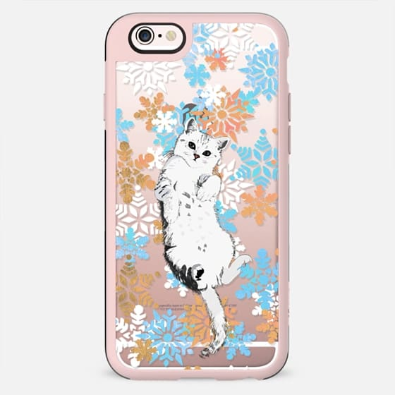 White kitty and colorful snowflakes