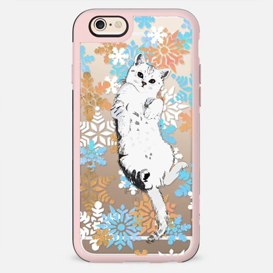 White kitty and colourful painted snowflakes
