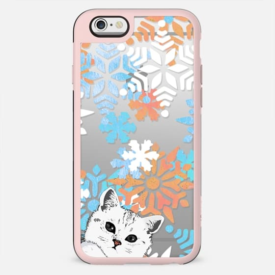 White kitty and painted snowflakes