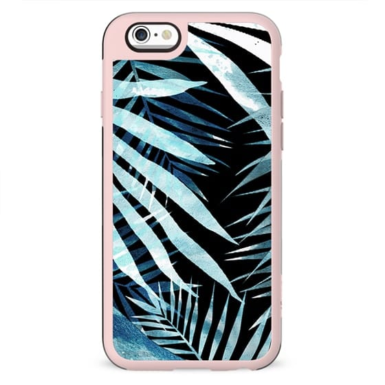 Blue painted tropical palm leaves