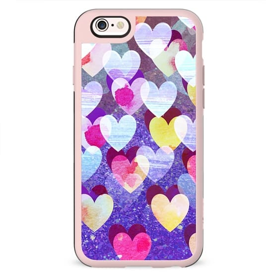 Colorful painted hearts and purple sparkles