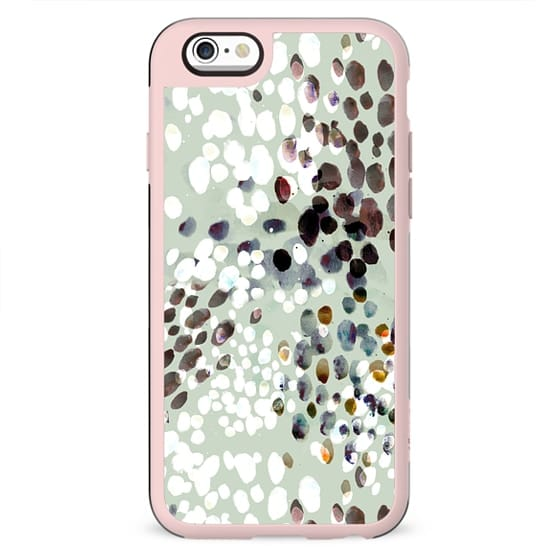 Painted animal print dots on pastel green