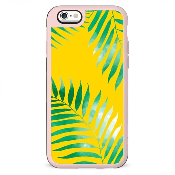 Bright tropical green watercolor palm tree hand drawn on bright yellow by Girly Trend